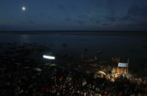 People congregate on the banks of the River Ganges watching a total solar eclipse in Varanasi, India, Wednesday, July 22, 2009. (AP Photo/Saurabh Das)